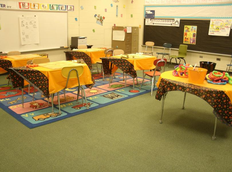 Tables set up with games and prizes for Fall Festival.