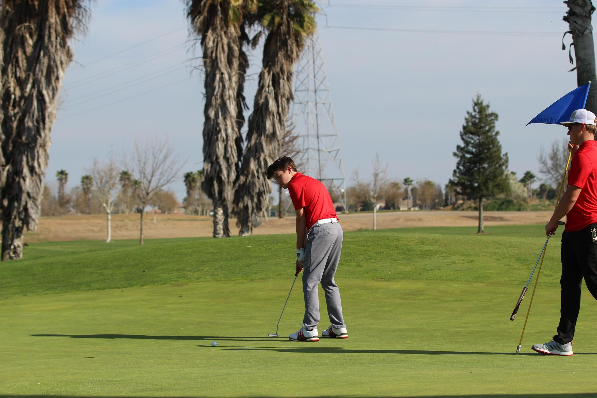 boys golfing against Madera South