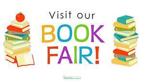 Book fair sign with books surrounding it