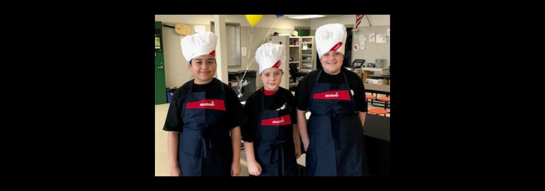 Three student chefs in uniform.