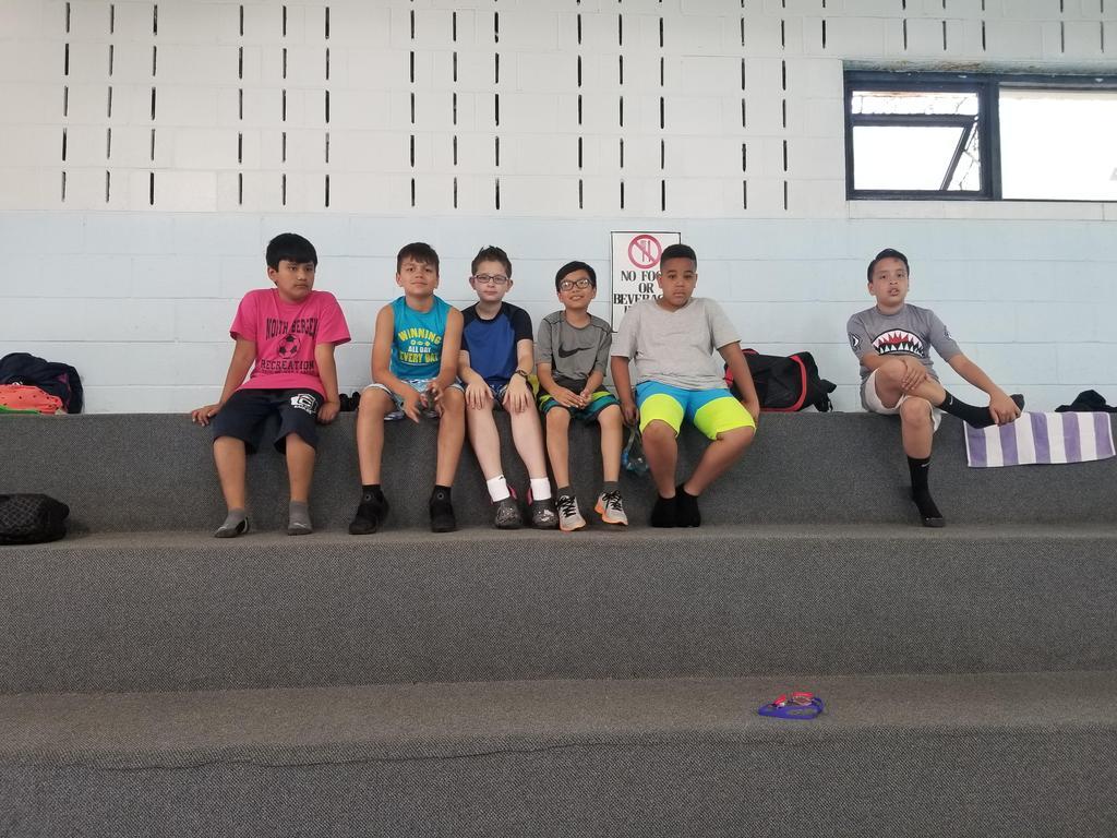 Regatto supporters sitting