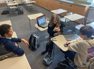 Students creating a podcast.