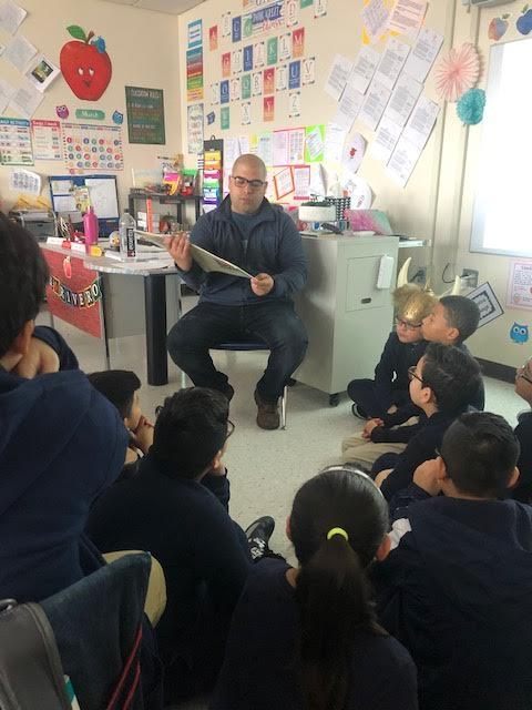 father reading to class
