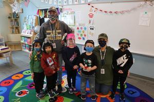 preschool students in hats