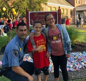Two Franklin students get special escort from Westfield police officer on Walk to School Day.