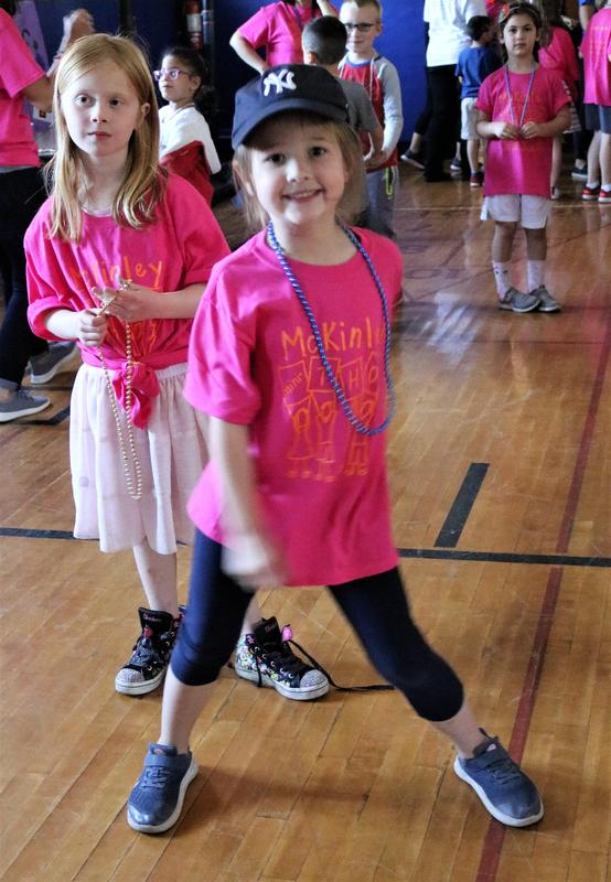 Photo of two McKinley students during the 8th Annual McKinley-Thon when students and staff dance to raise money for pediatric cancer research.