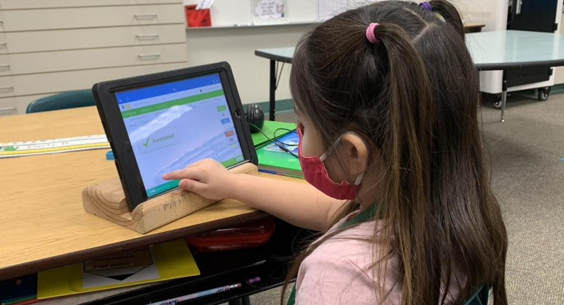 1st Grade Student working on IXL