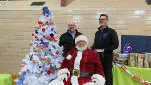 Assistant Superintendent Gregg Russell and Special Education administrator Jason Hillman visit with Santa.