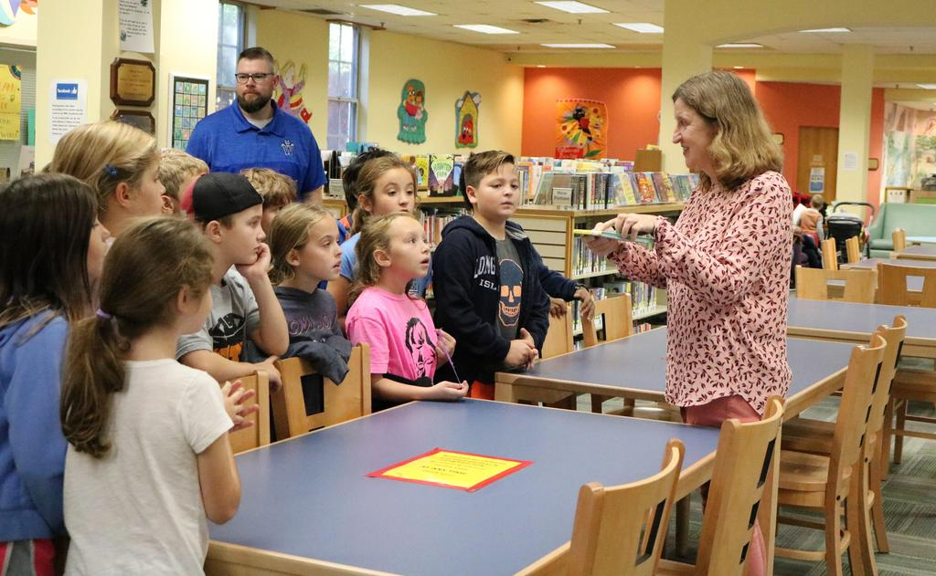 Westfield Memorial Library's Molly Adams gives McKinley 3rd graders a tour on Oct. 23 that included a discussion of the Summer Reading Program, the difference between fiction and non-fiction, the Dewey Decimal System, and other topics.