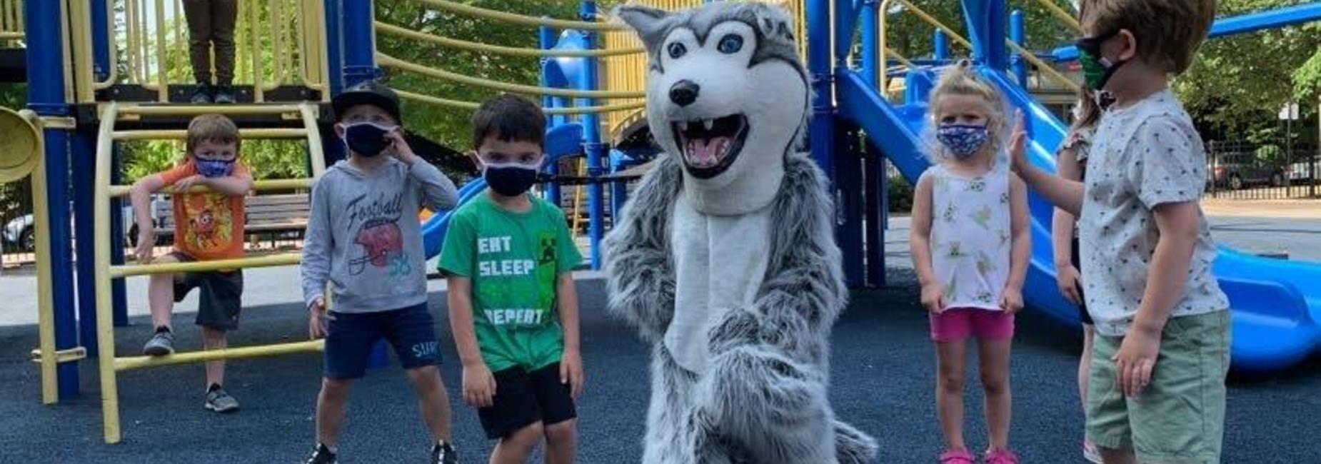 Kids playing outside with mascot