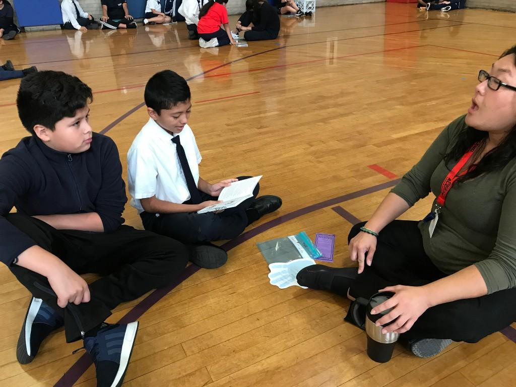 Ms. Takemoto assists students with reading