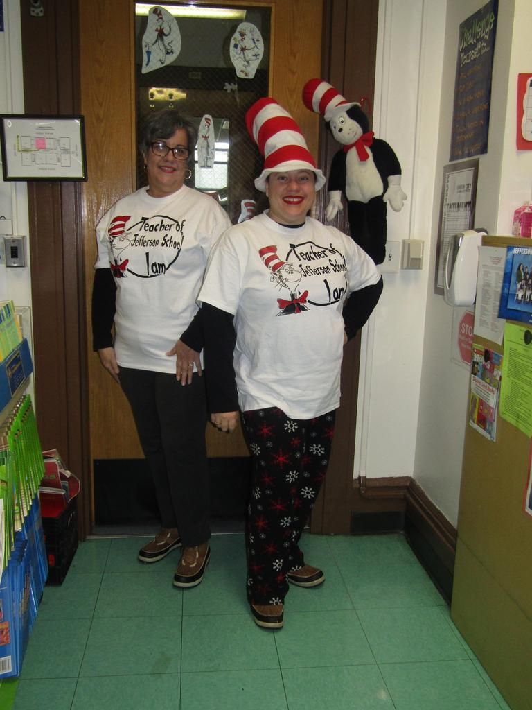 two teachers proudly posing with their seuss t's