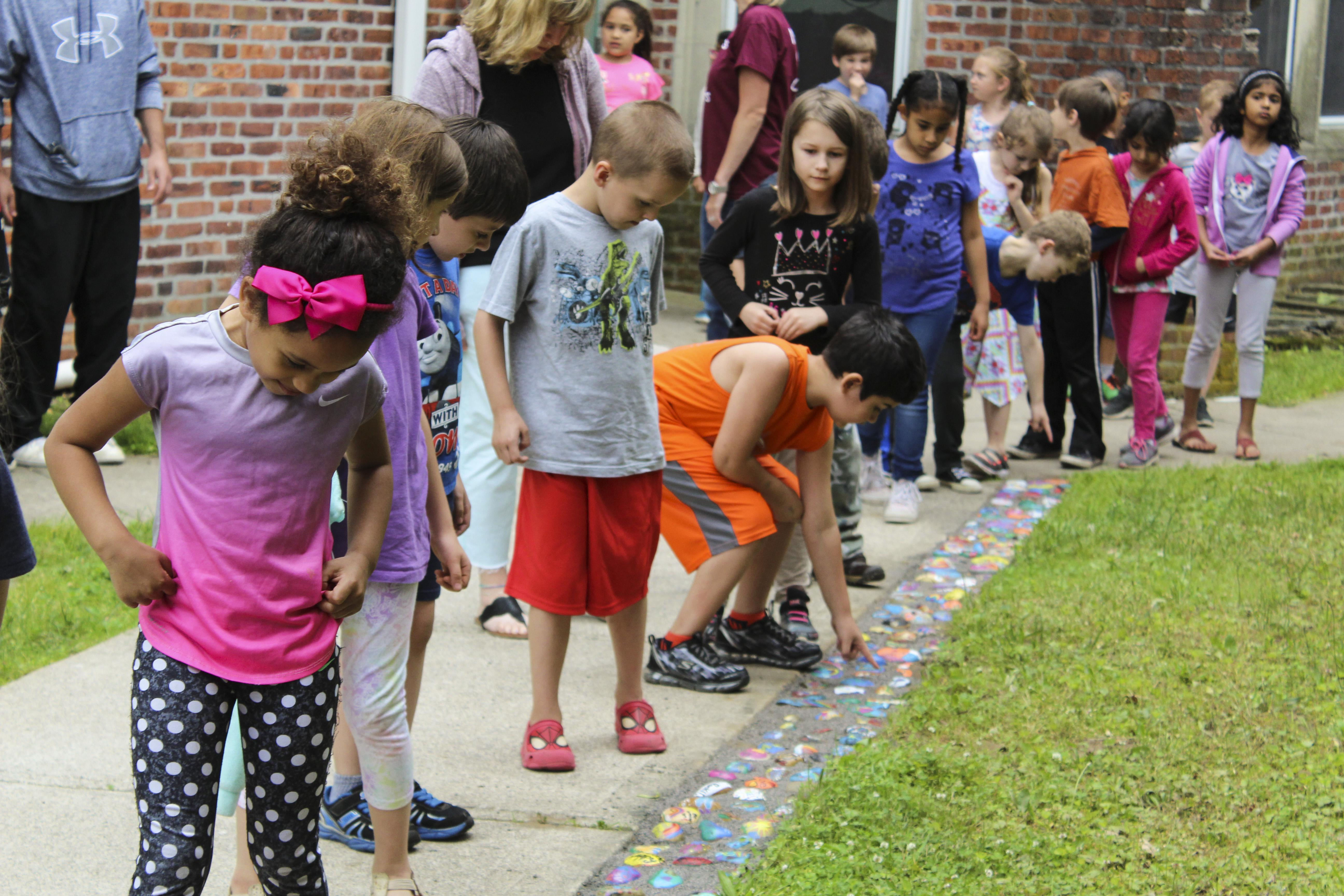 Students looking at kindness rocks walk