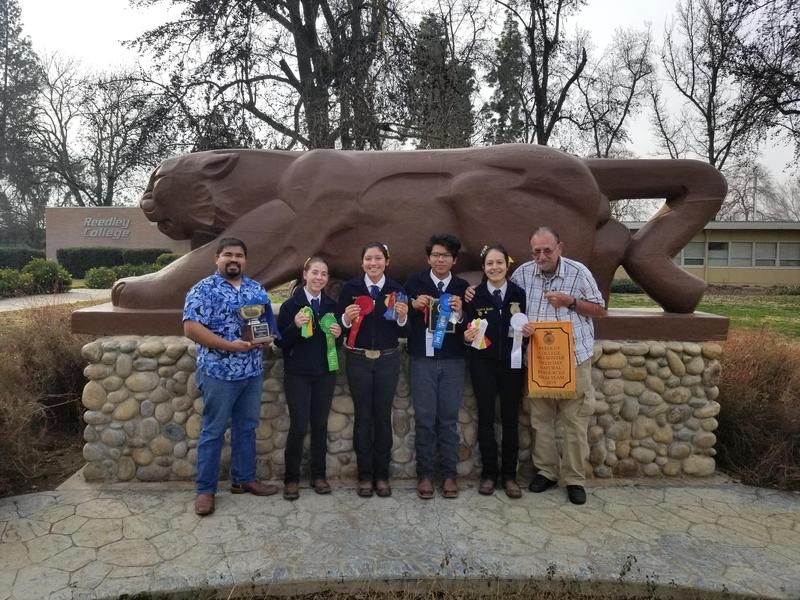 FFA Natural Resources team members pose with their first place trophy at state finals.