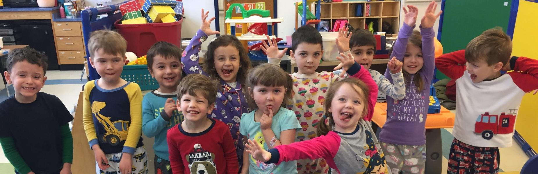 Pre-kindergartners at Lincoln School have fun as they pose for a picture on Pajama Day.