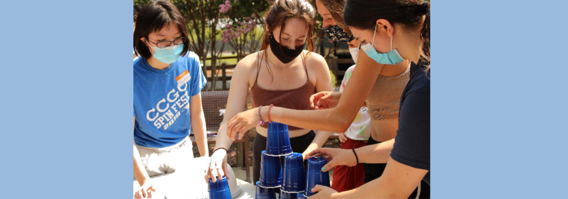 Student completing an activity with cups.