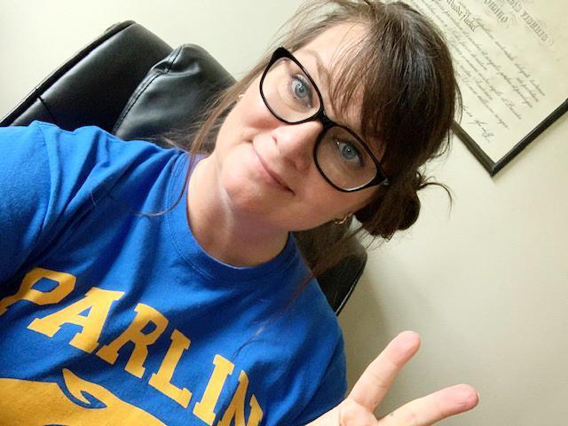 A teacher, selfie, wearing a Parlin T-shirt