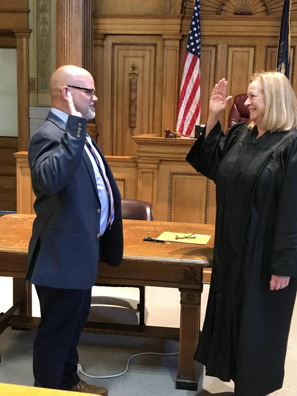 Dennis Peachey takes the Oath of Office
