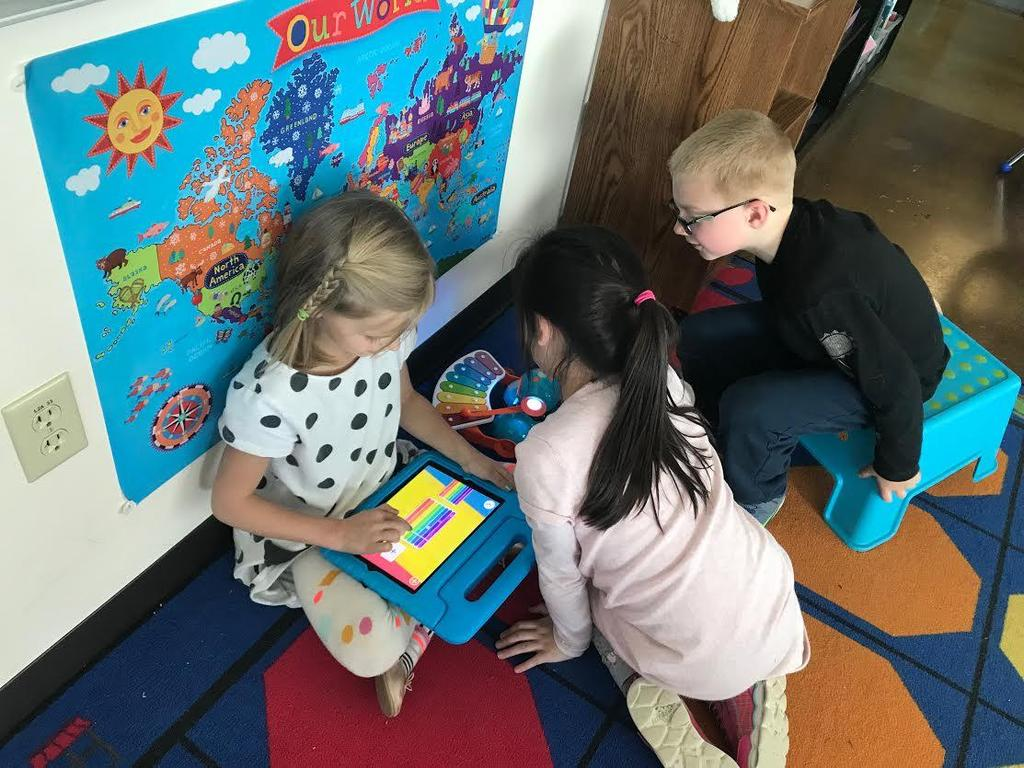 Second graders write poems and code Dash robots to play a song to accompany the poem.