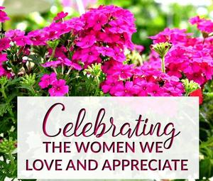pink flowers and sign celebrating women we appreciate