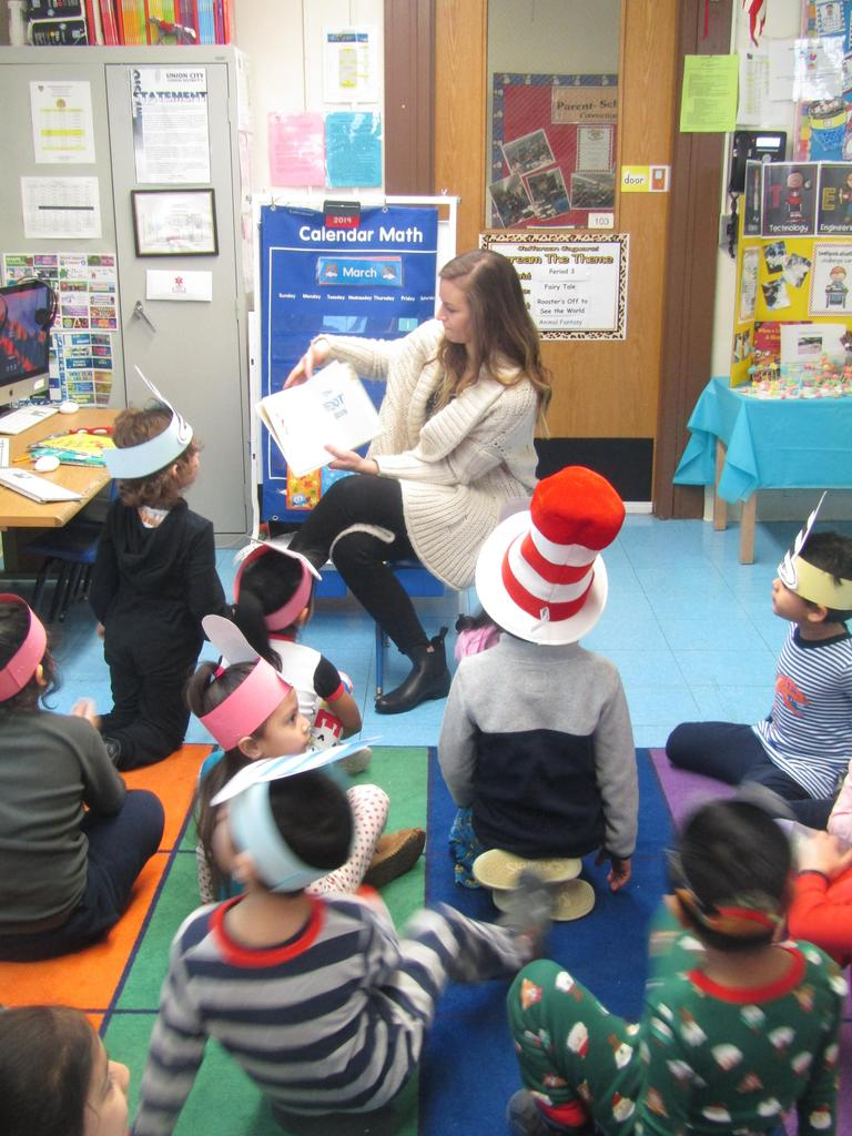 teacher reading to pre-k class