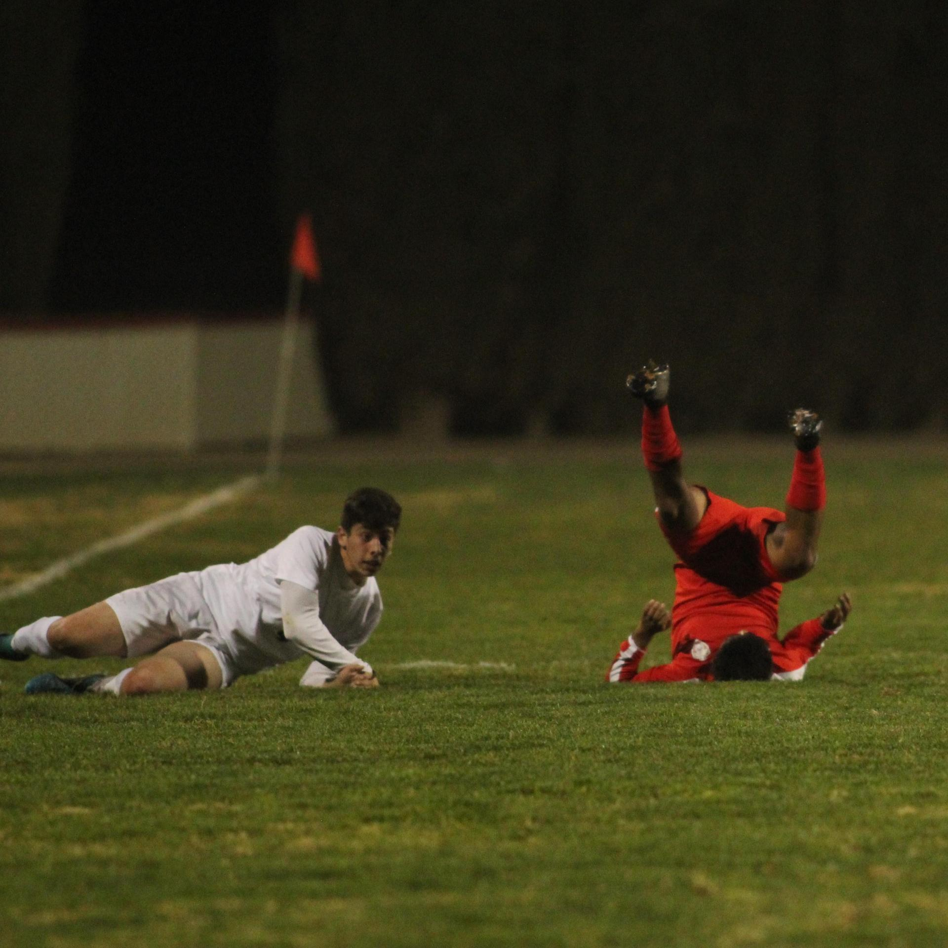 Alejandro Montes Laying on the Ground