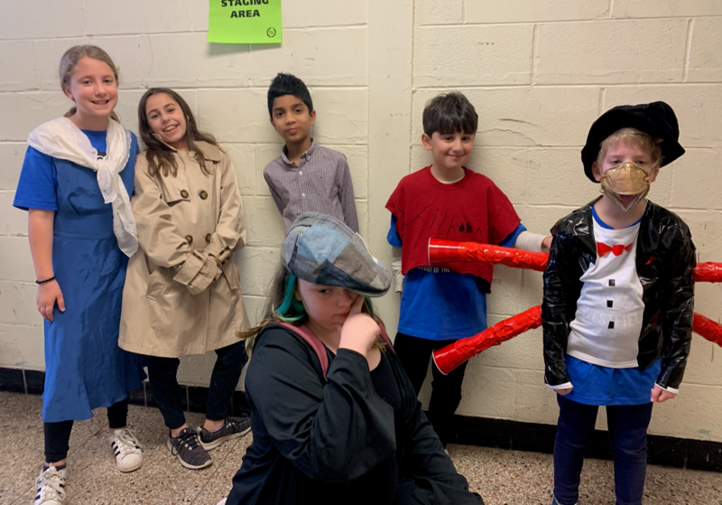 Photo of elementary students participating in Odyssey of the Mind tournament in March.