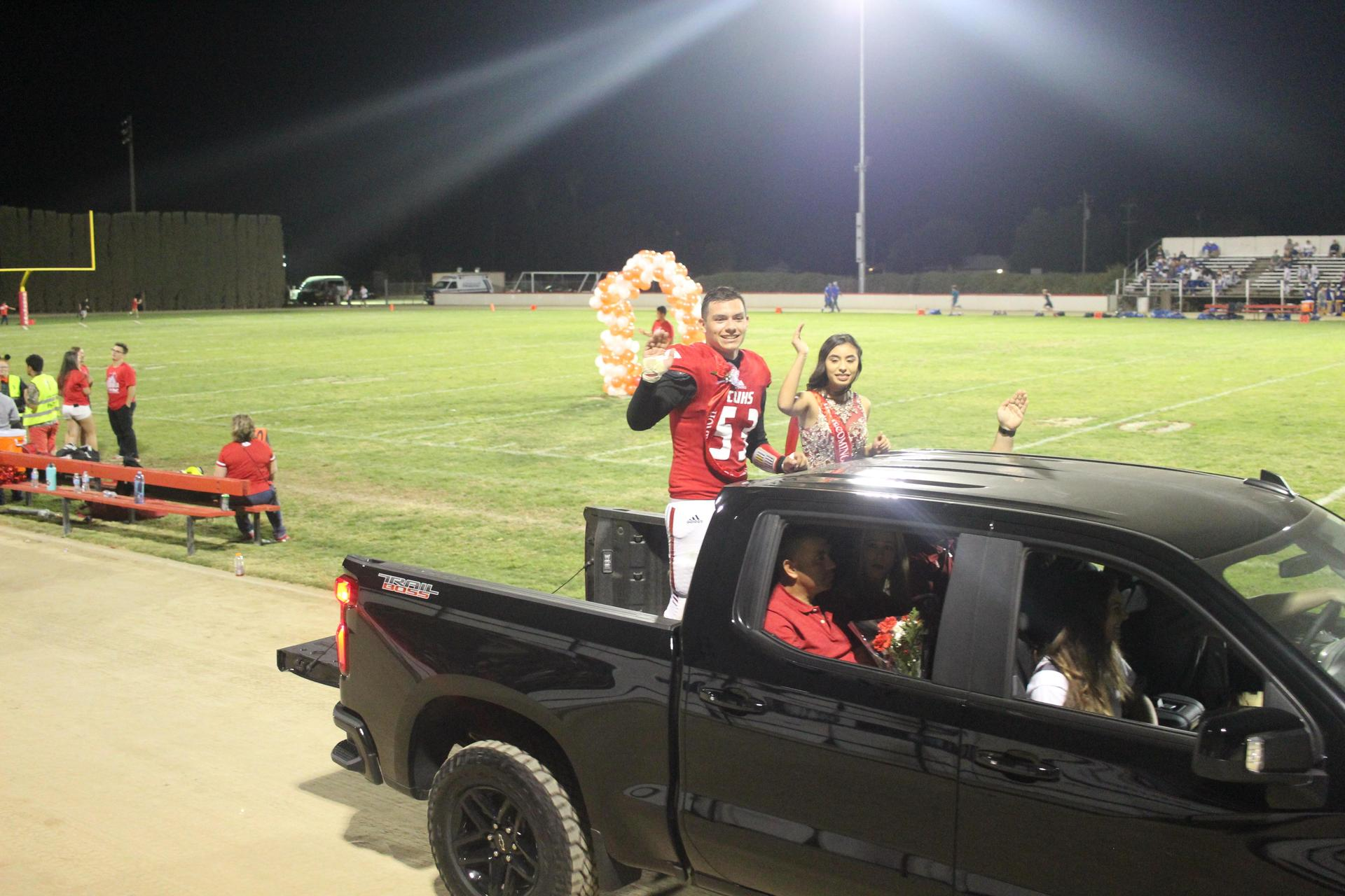 Homecoming Royalty in cars