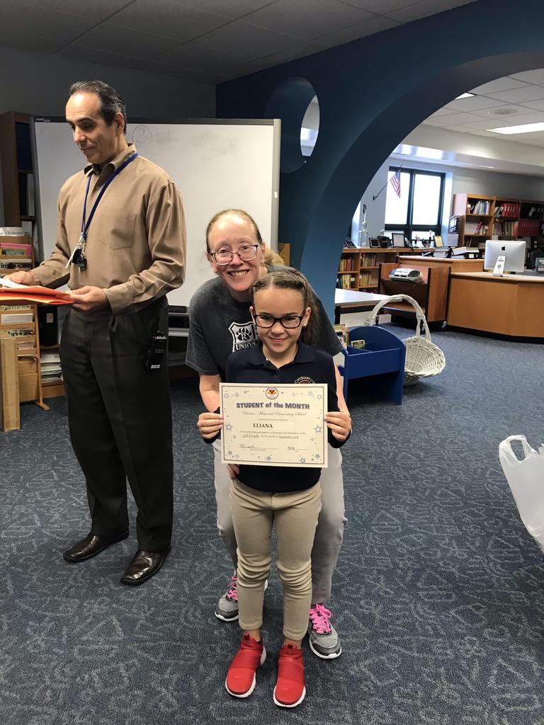 student of the month eliana grade 3 with principal O'connel