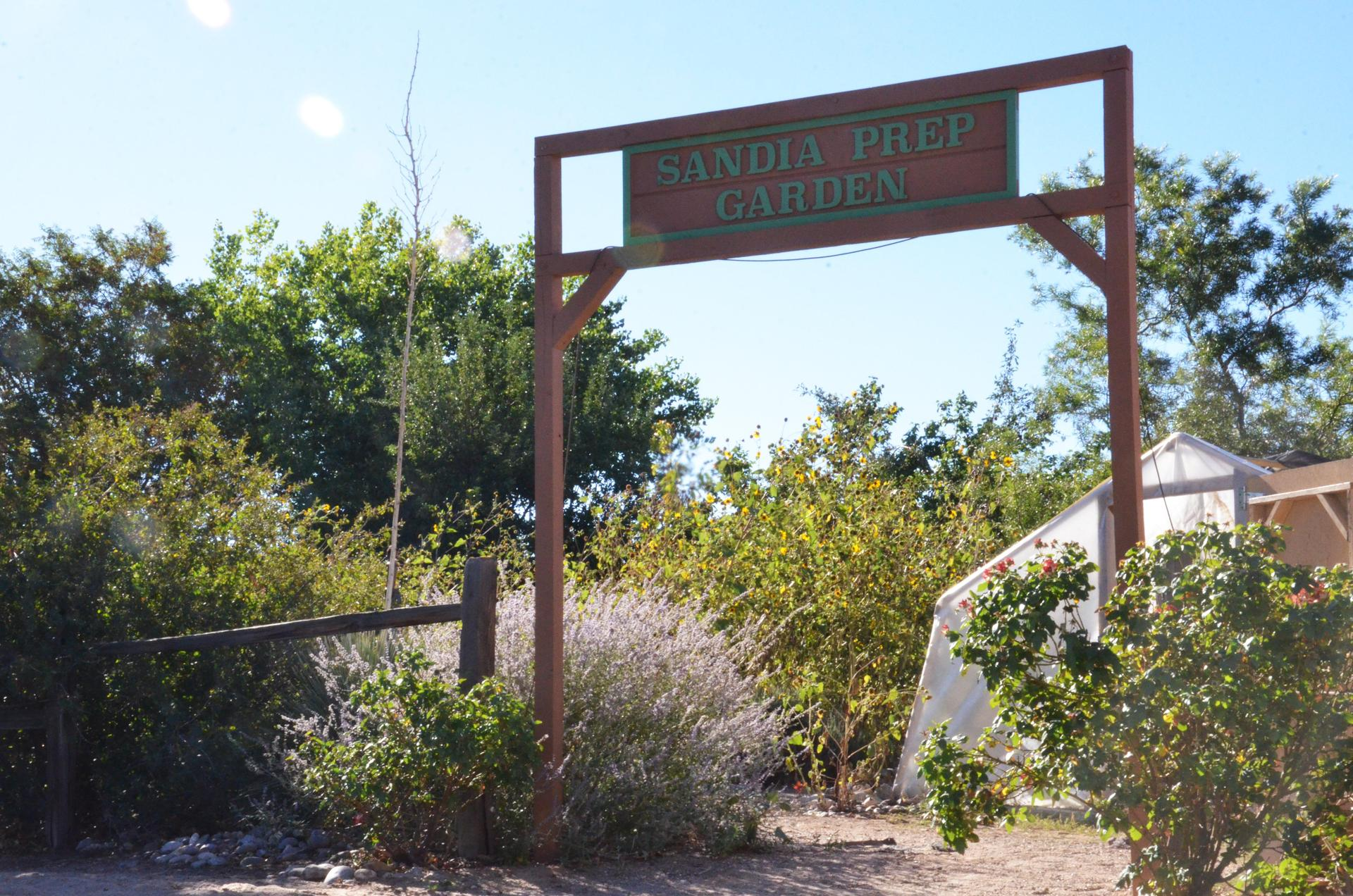 Entrance of Sandia Prep garden with welcome sign