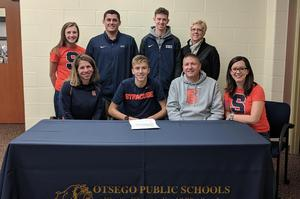 Alex with his parents, coaches, teammate and girlfriend at his signing.