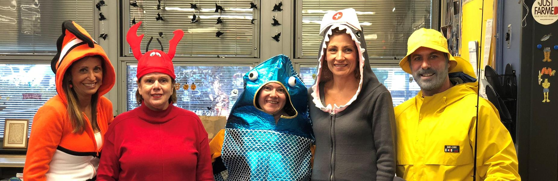 Tamaques principal David Duelks dresses as a fisherman with his staff as various ocean critters for Halloween 2018.