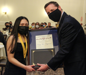 Dr. Hambleton presents the award to Salutatorian Carly Ann Magpantay during the Top Ten Event dinner.