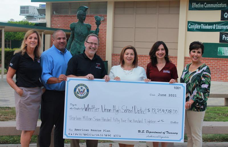 relief funds photo with district admin