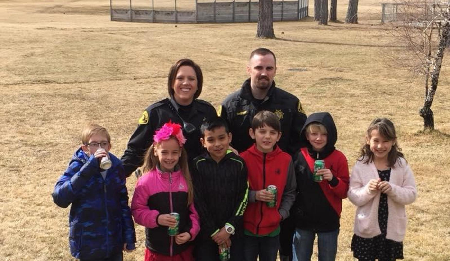 3rd Graders sharing a Pop with a Cop