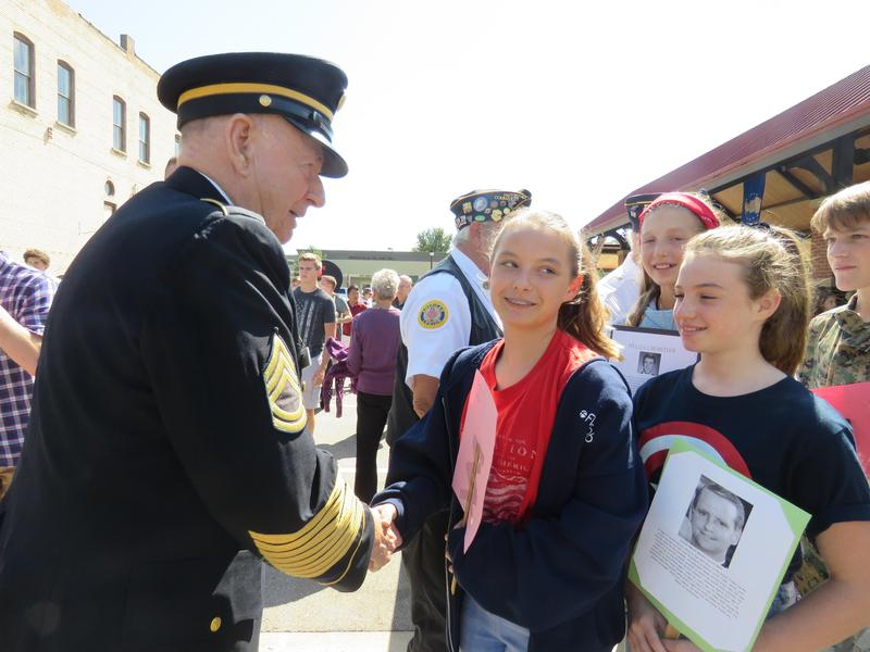 TKMS students shake hands with a veteran at the 9-11 Patriot Day ceremony.