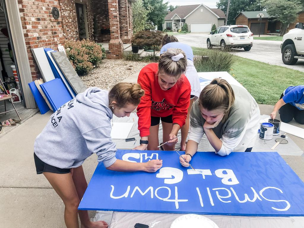 HS Cheerleaders painting signs