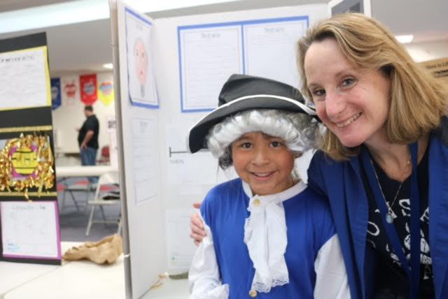 Principal Dr. Groth with a student during the wax museum