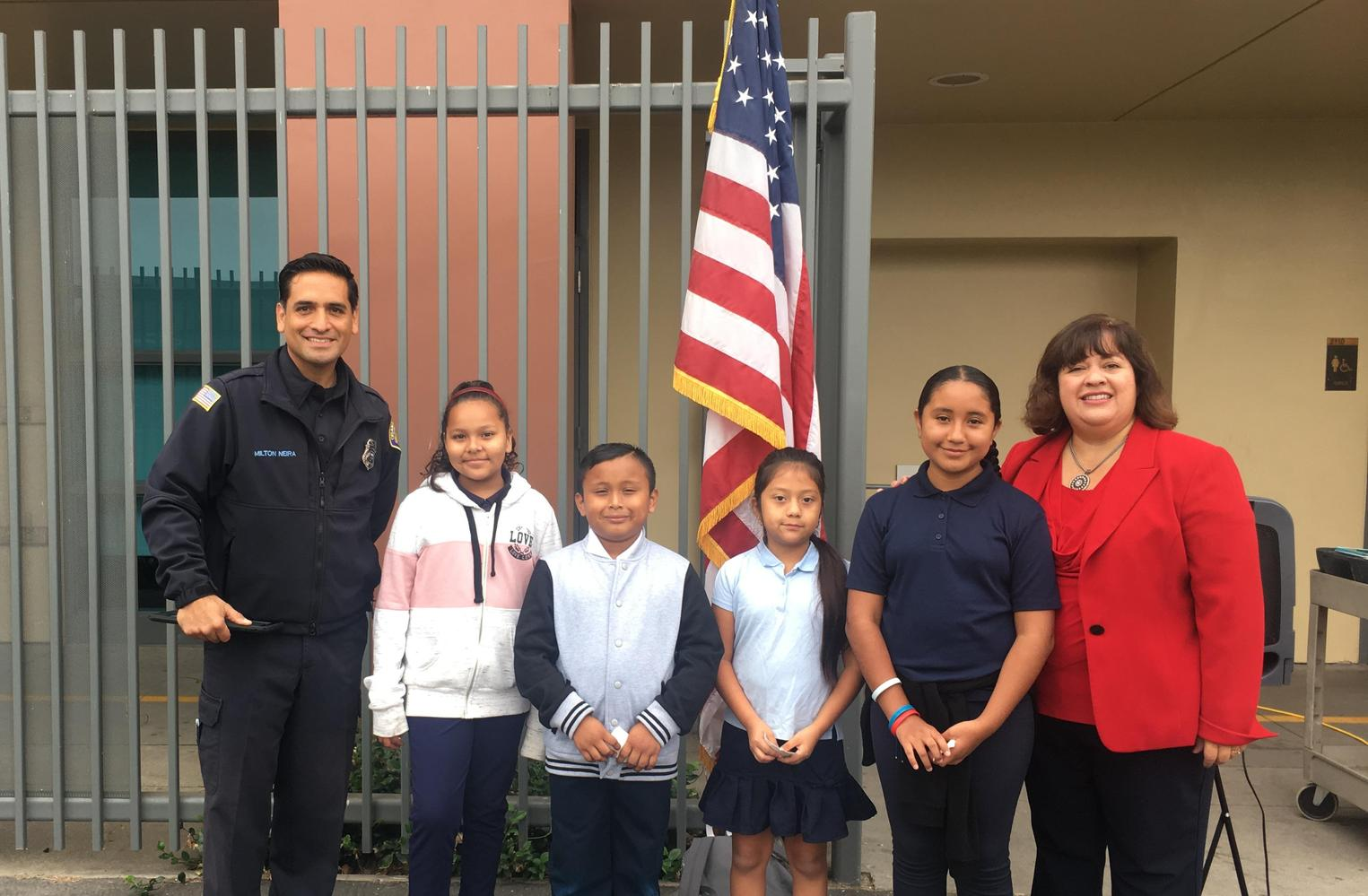 Students with firefighter and principal