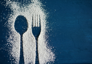 spoon and fork outline in salt with blue background