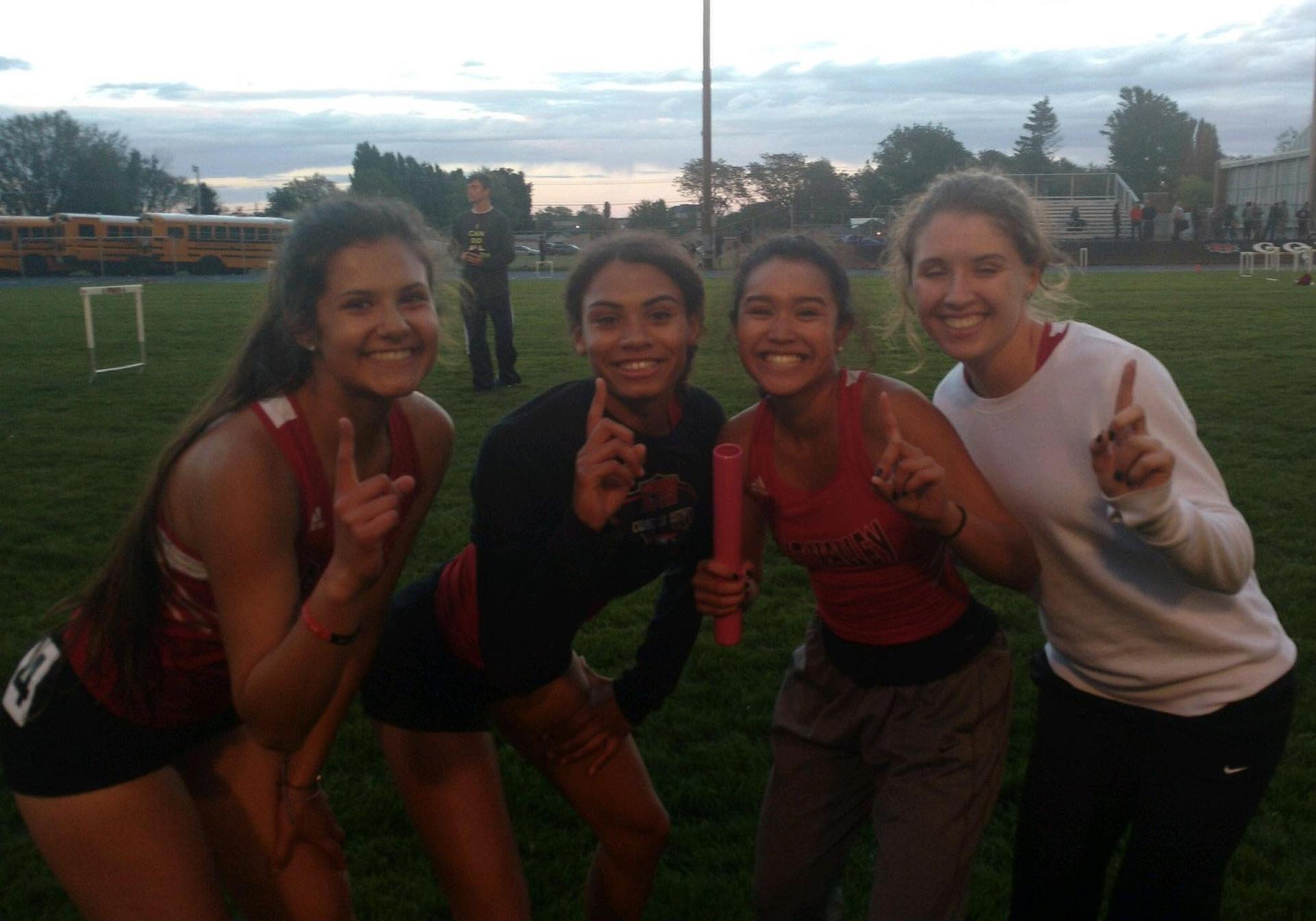 Girls 400m relay team wins District Title.
