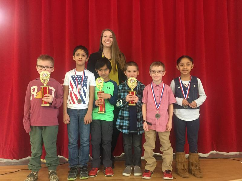 Lamar Elementary first grade spelling winners left to right holding their trophies