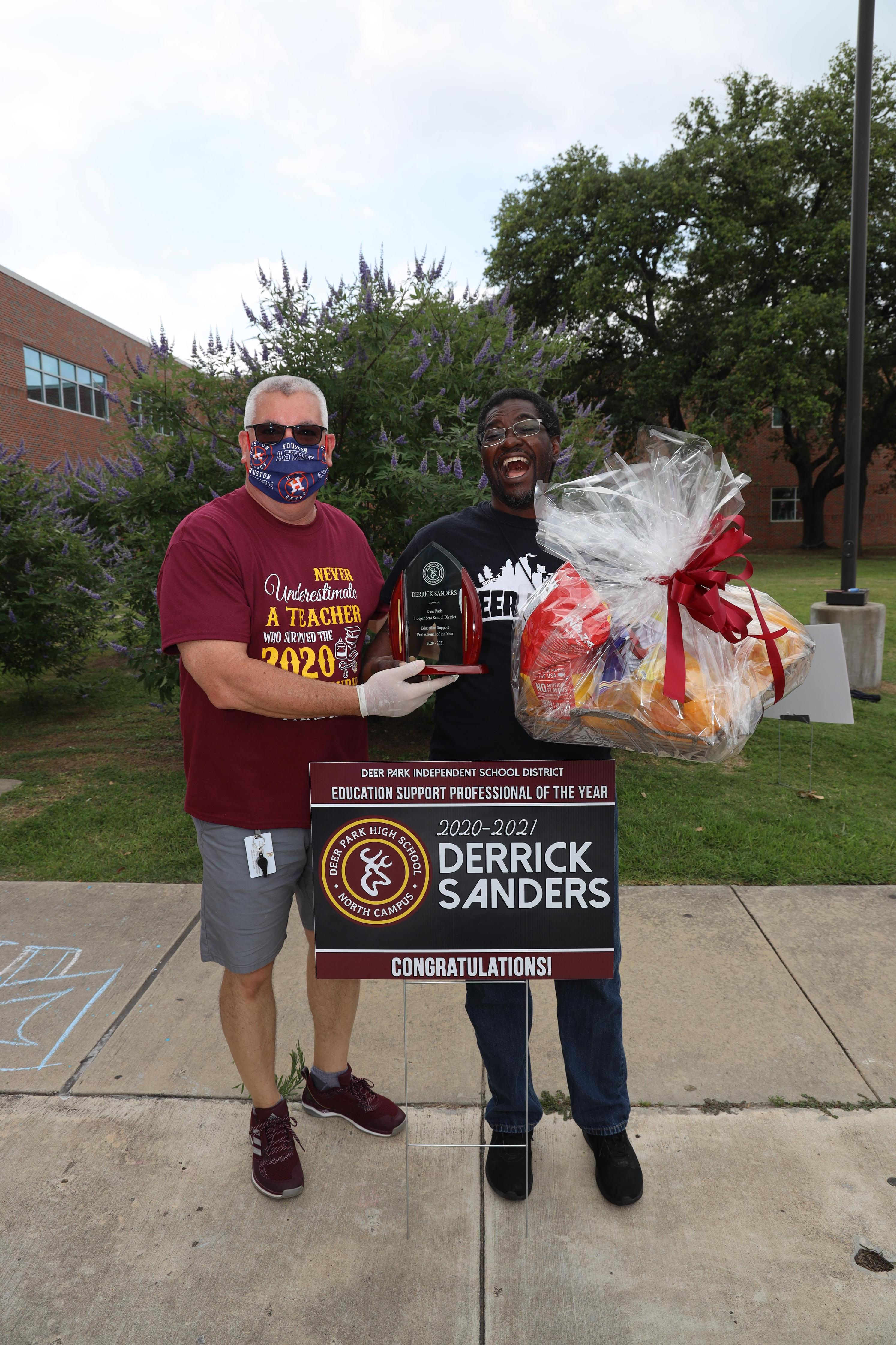 Presenting the support professional award to Derrick Sanders