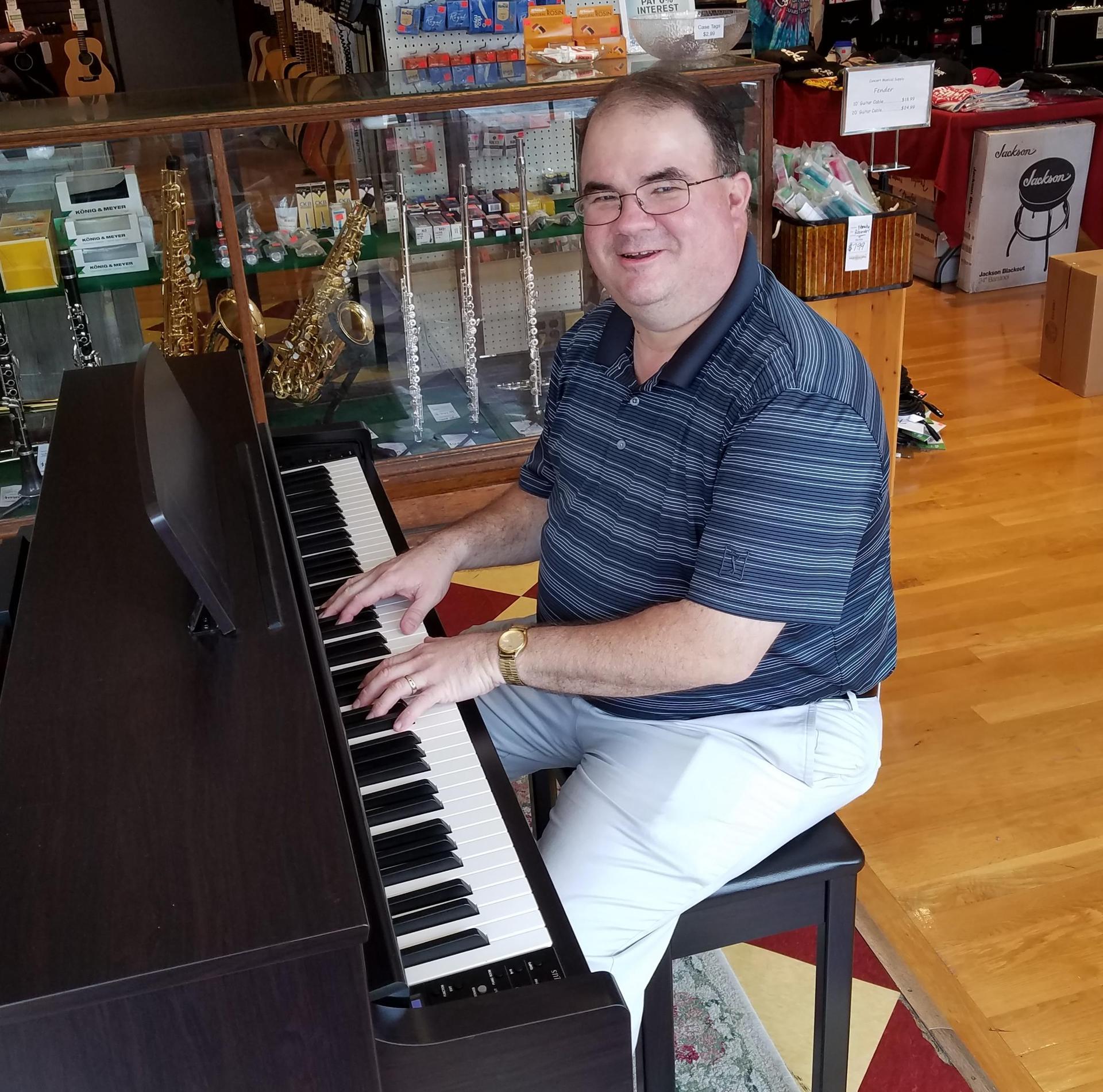 Mr. Hamby at the keyboard
