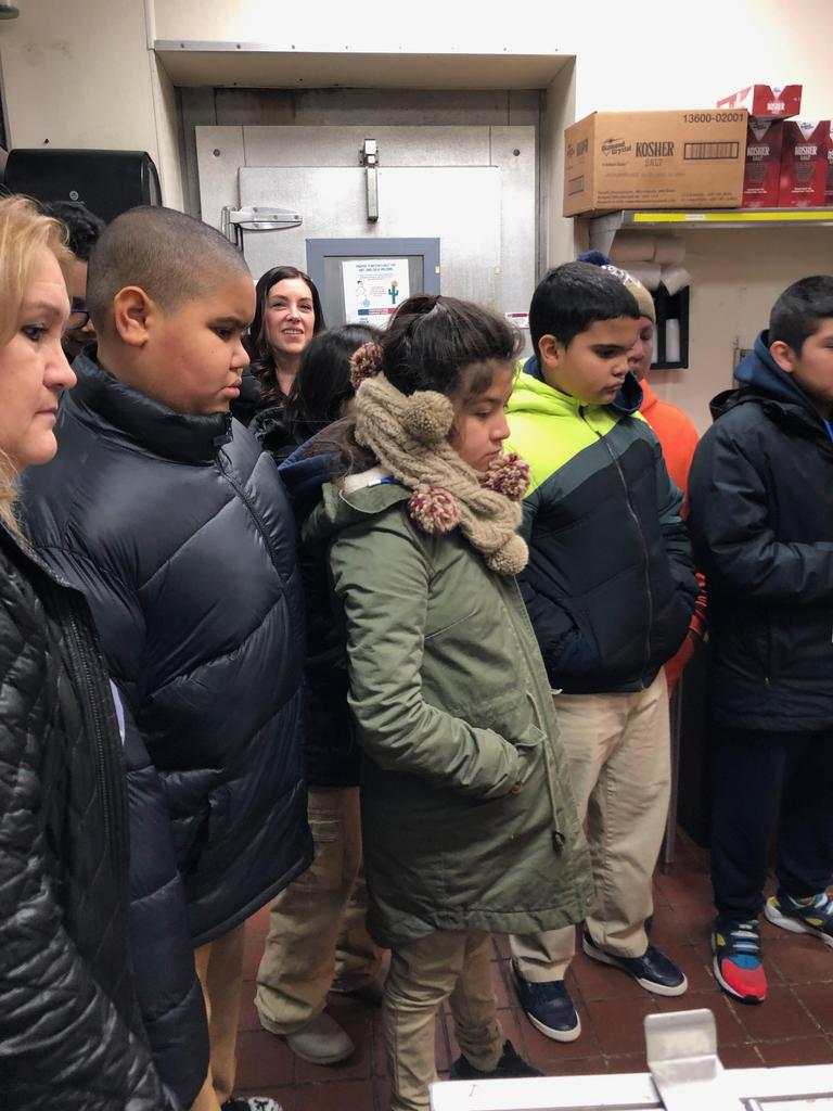 Children looking at the stations in the kitchen