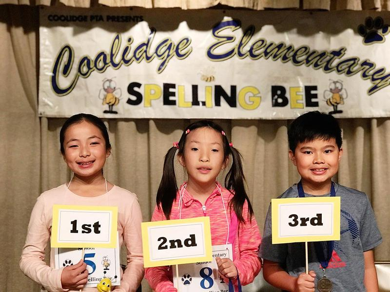Three Coolidge elementary students pose for the camera with their rankings.