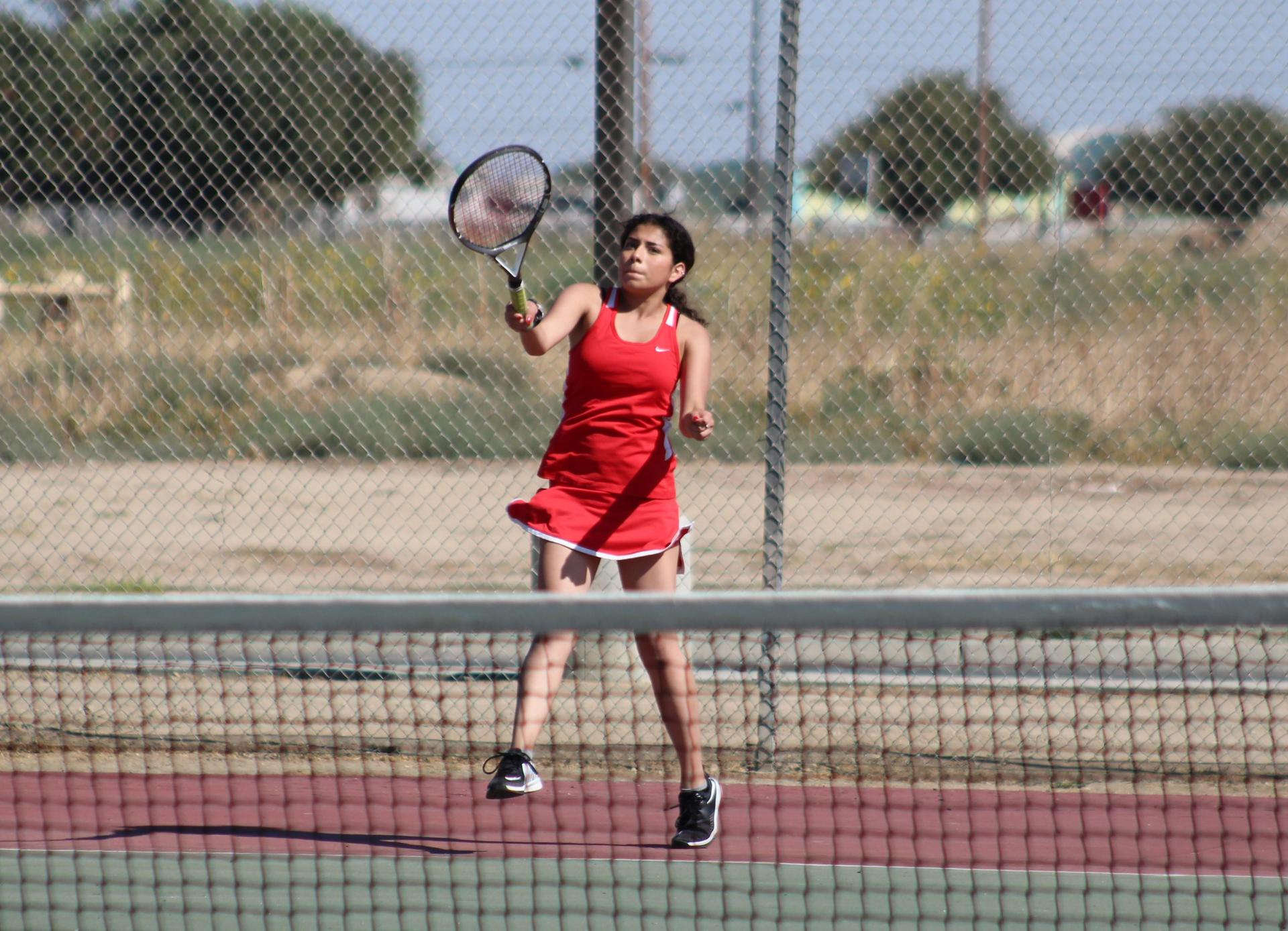 Girls playing Tennis against Selma