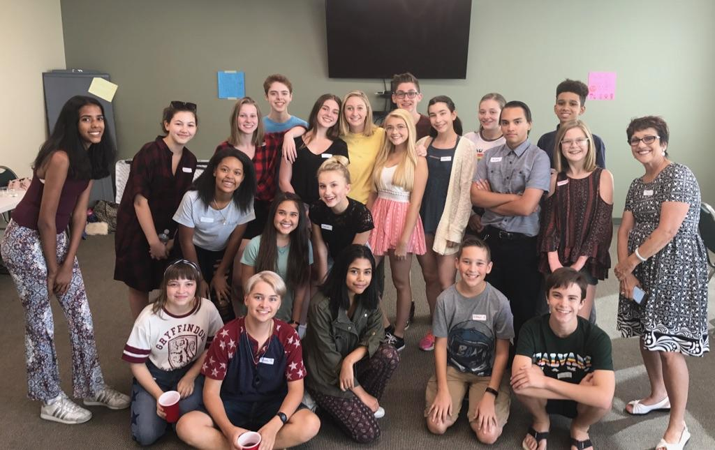 Picture of ASB students sitting and standing smiling big for the camera!