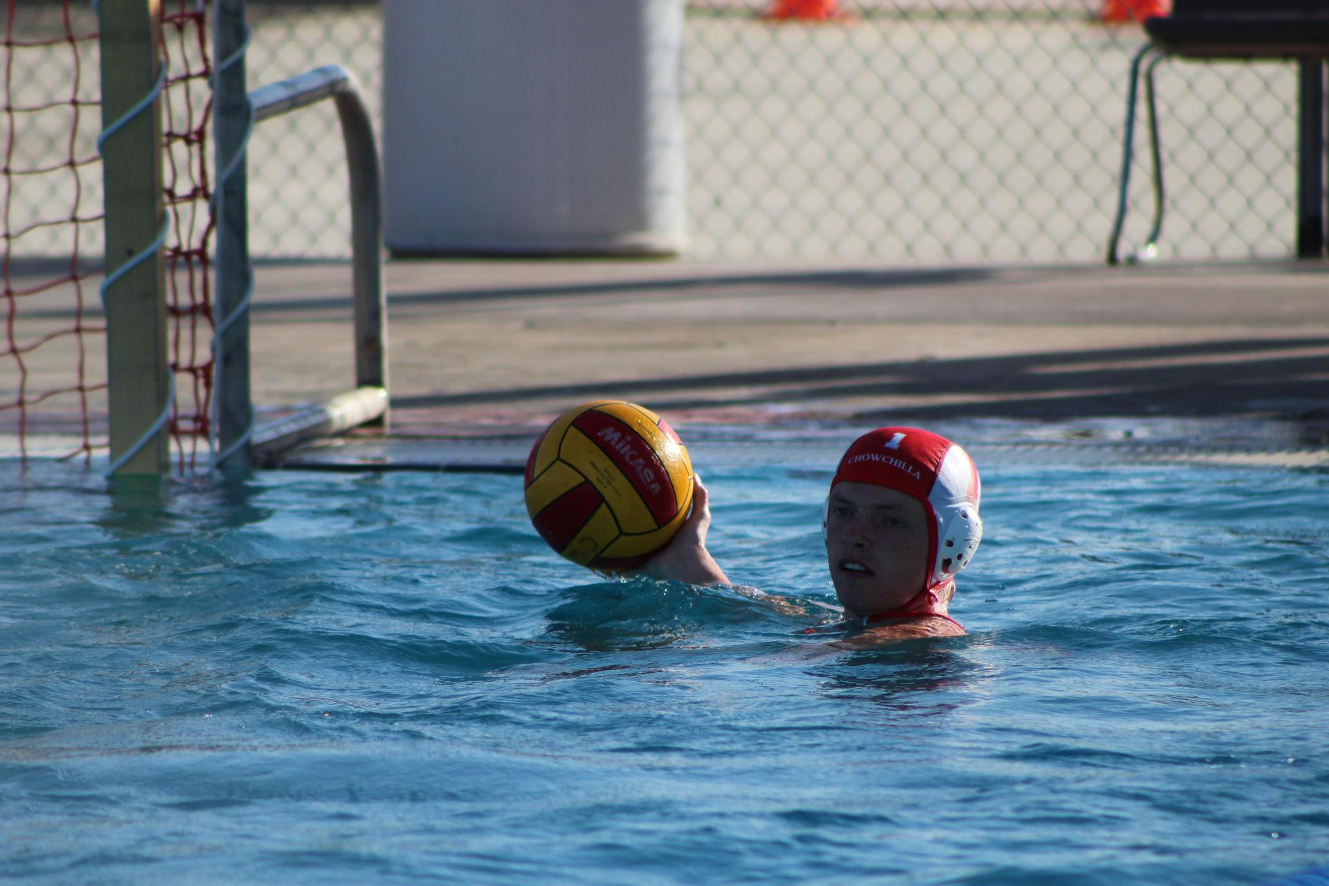 Boys playing water polo vs Fresno