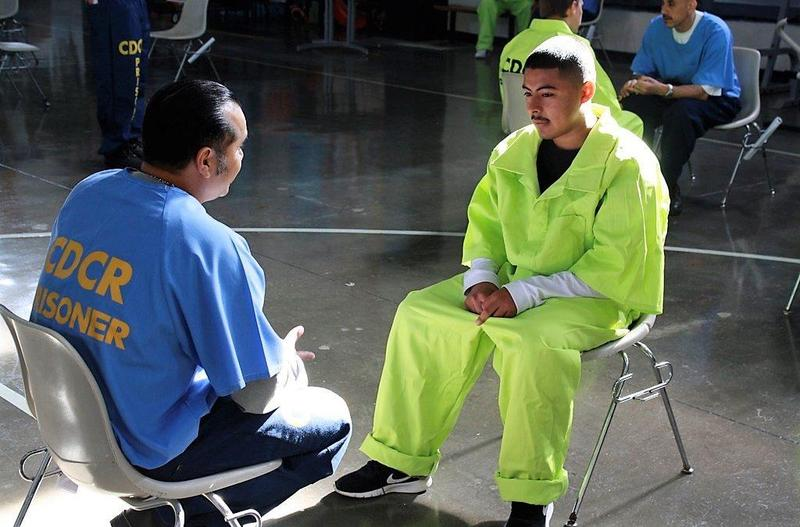 CHS student speaking with inmate